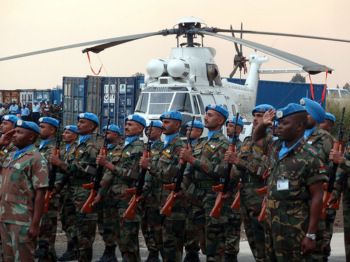 UN troops stand at attention at Secretary Clinton's arrival in Goma