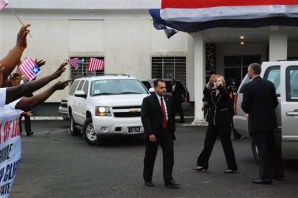 U.S. Secretary of State Hillary Rodham Clinton, second from right, gestures to Liberian supporters after giving an address to parliament in Monrovia, Liberia, Thursday, Aug. 13, 2009.(AP Photo/Pewee Flomoku)
