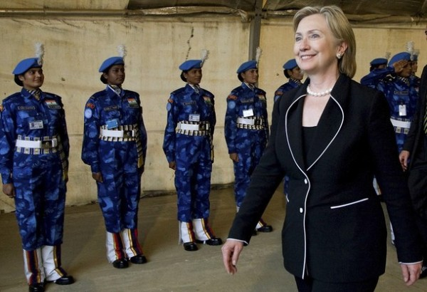 U.S. Secretary of State Hillary Clinton reviews an honour guard of U.N. Indian police during a welcoming ceremony at Roberts International Airport near Monrovia August 13, 2009.   REUTERS/Glenna Gordon/Pool