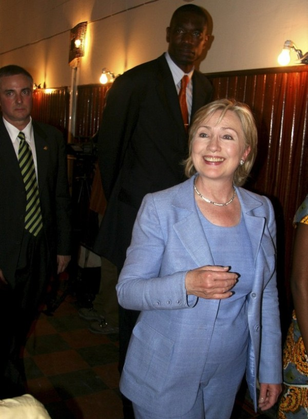 Secretary Clinton arrives at town hall mtg with NBA basketball star Dikembe Mutombo (REUTERS/Joe Bavier)