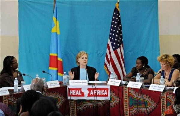 US Secretary of State Hillary Rodham Clinton, center, addresses a panel discussion with several NGO organizations  the Heal Africa clinic in Goma, Congo Tuesday Aug. 11, 2009. (AP Photo/Roberto Schmidt, Pool)
