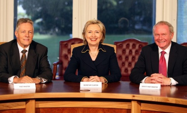 US Secretary of State Hillary Clinton (C) poses for pictures with Northern Ireland's First Minister Peter Robinson (L) and Deputy First Minister Martin McGuinness (R) at Stormont Castle in Belfast, on Monday October 12, 2009. Secretary of State Hillary Clinton was on Monday to offer renewed US support for Northern Ireland's peace process and help to resolve a political stand-off threatening its power-sharing government. Clinton was in Belfast to meet the province's leaders and make a major speech to its assembly, in a bid to boost efforts to defuse the row which has brought the fragile cross-community administration to a standstill. AFP PHOTO/Paul Faith/WPA POOL (Photo credit should read PAUL FAITH/AFP/Getty Images)